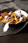 Mango and feta stir fry with red onions and olives