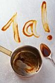 '1a!' Abdruck aus dunkler Sauce