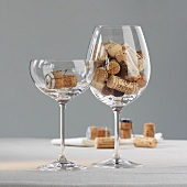 Wine and champagne corks in glasses