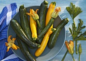 Yellow and green courgette with flowers