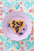 A heart-shaped blueberry pancakes