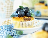 Cupcake with grape hyacinth and blueberries