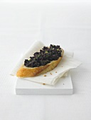 Baguette slice with Bloodwurst (Caviar of Cologne)