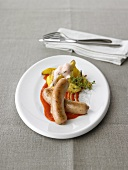 Shrimp sausage with pepper jus and saffron potatoes