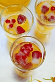 Orangeade with berry ice cubes