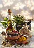 Sill life with spices, herbs and herb oil