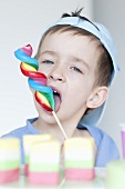 Young boy with a spiral shaped lollipop