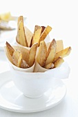 Roasted potato wedges in paper cups