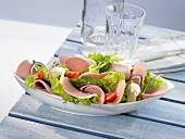 Cold cuts with salad greens, poultry sausage and champignons