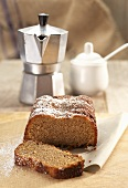 Box-shaped espresso cake, espresso pot and sugar bowl
