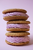 Three stacked whoopie pies with raspberry filling