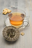 Tee cup with old fashioned tea strainer