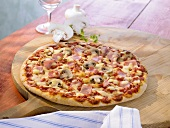 Pizza al funghi with mushrooms and ham
