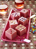 Punch ice cubes with milk chocolate candies