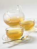 Tea in glass cups and a glass teapot