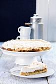 Gooseberry-meringue cake, sliced open