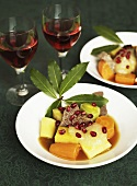 Boiled fillet of beef with vegetables, applesauce and pomegranate seeds