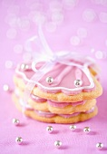 Shell shaped cookies with pink icing and silver pearls