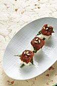 Spicy marinated tuna fish with Nori on sushi rice