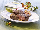 Venison steak with sliced figs