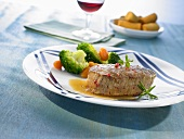 Beef fillet steak with vegetables and potato croquettes