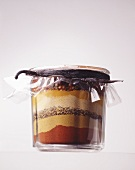 Layered spices closed with a vanilla pod