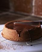 Icing a chocolate cake
