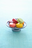 Several types of macaroons on a cake stand