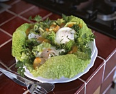 Poached eggs with vegetable salad in a savoy cabbage leaf