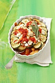 Zucchini casserole with tomatoes, cheese and sage