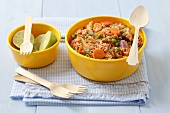 Rice with chicken, carrots, peas, limes