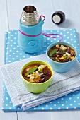 Vegetable soup with kidney beans, thermos