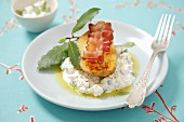 Baked potato with bacon on herb quark (curd)
