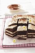 Tiramisu torte, sliced into pieces