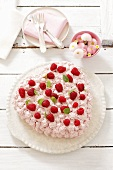 Heart-shaped biscuit cake with cream and raspberries