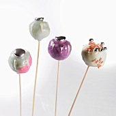 Cake pops with pastel colored and silver pearls