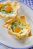 A spicy, stuffed puff pastry tartlet with egg and bacon