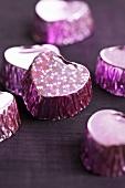 Purple-coloured, heart-shaped pralines