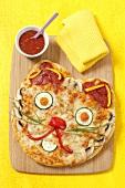 Katzengesicht-Pizza