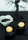 Coconut tapioca balls with chocolate sauce