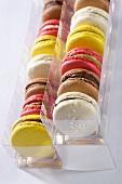 Various macaroons in plastic boxes