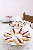 Coconut biscuits with raspberry jam