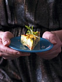A woman hold a rocket frittata on a plate