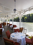 A pavillon restaurant by a lake (Hotel Pavillon Bleu)