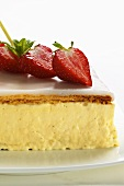 A cream slice with strawberries