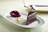 A piece of chocolate cake with blackcurrant sorbet