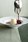Quark souffle with berry sauce