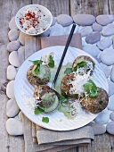 Thai meatballs with green curry sauce and coconut