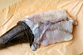 Monk fish being skined