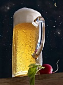 Larger in a glass tankard and a radish against a starry sky